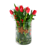 Røde tulipaner i glassvase